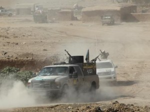 Popular Mobilization Forces (PMF) take part in an operation against Islamic State militants south of Mosul